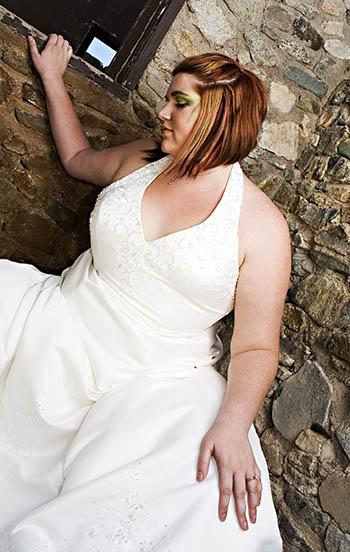 Beautiful plus size bride posing in wedding dress