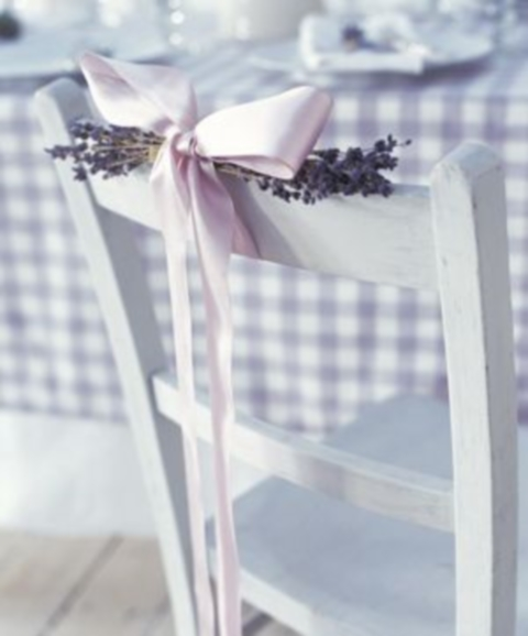 Adorable chair decoration ideas! - weddingfor1000.com bow and lavender