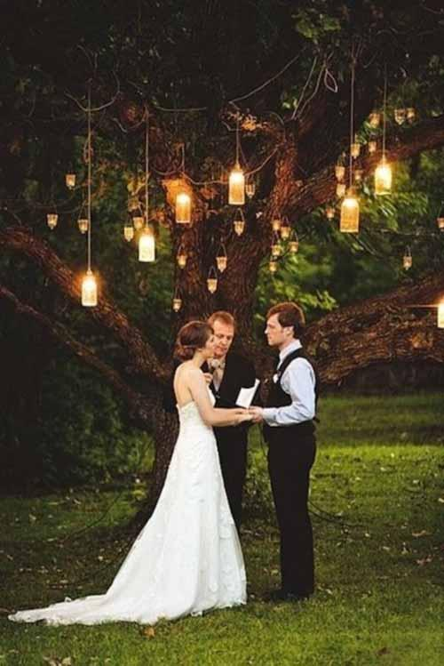 lanterns strung in trees weddingfor1000.com
