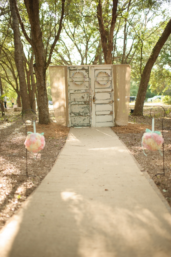 repurposed doors ceremony backdrop weddingfor1000.com