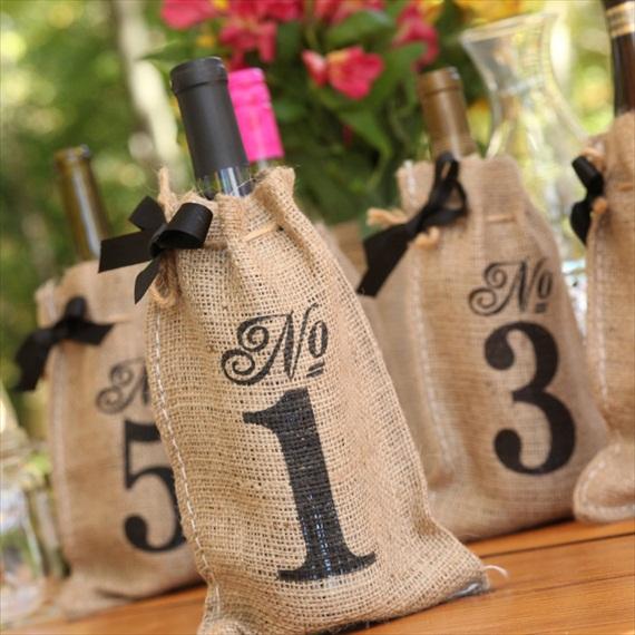 wine-bottle-table-numbers-burlap-bags