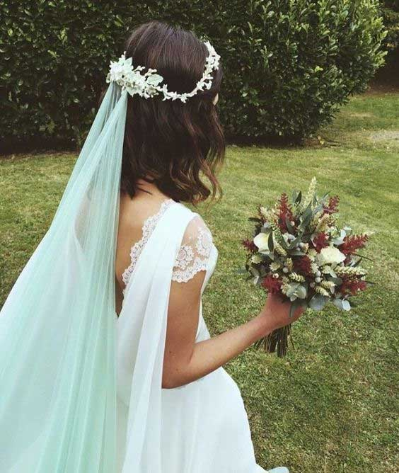 Soft blue accents your wedding day look