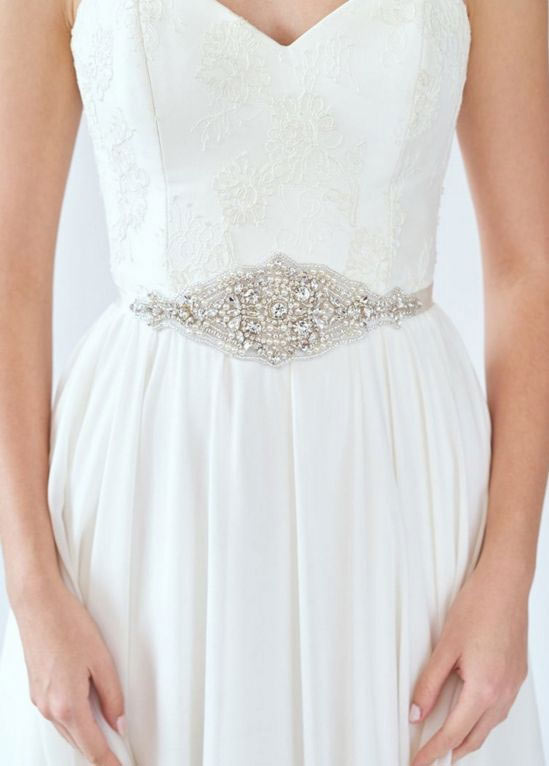 A beaded belt cinches your wedding day look